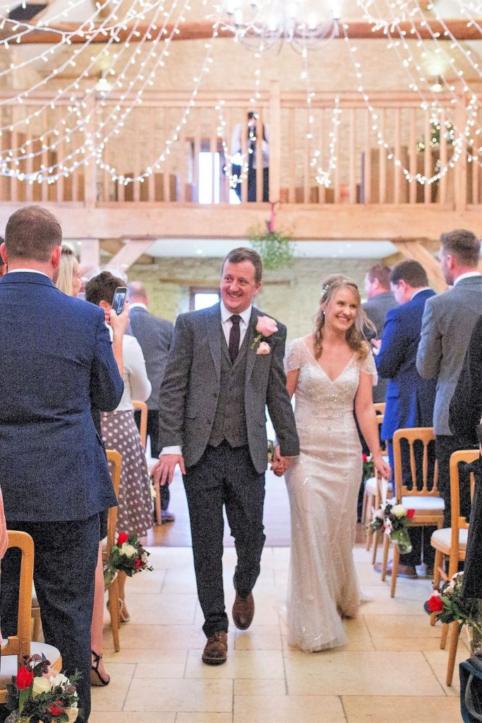 smiling bride groom just married kingscote barn tetbury oxford wedding photographer