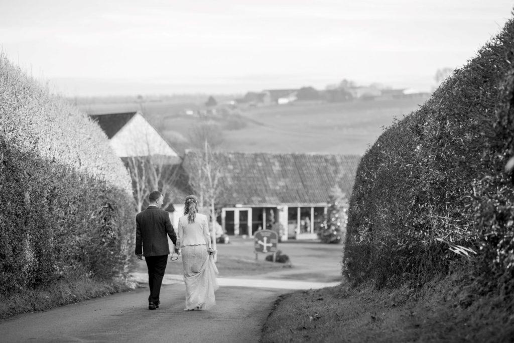 bride groom stroll in grounds kingscote barn tetbury oxford wedding photography