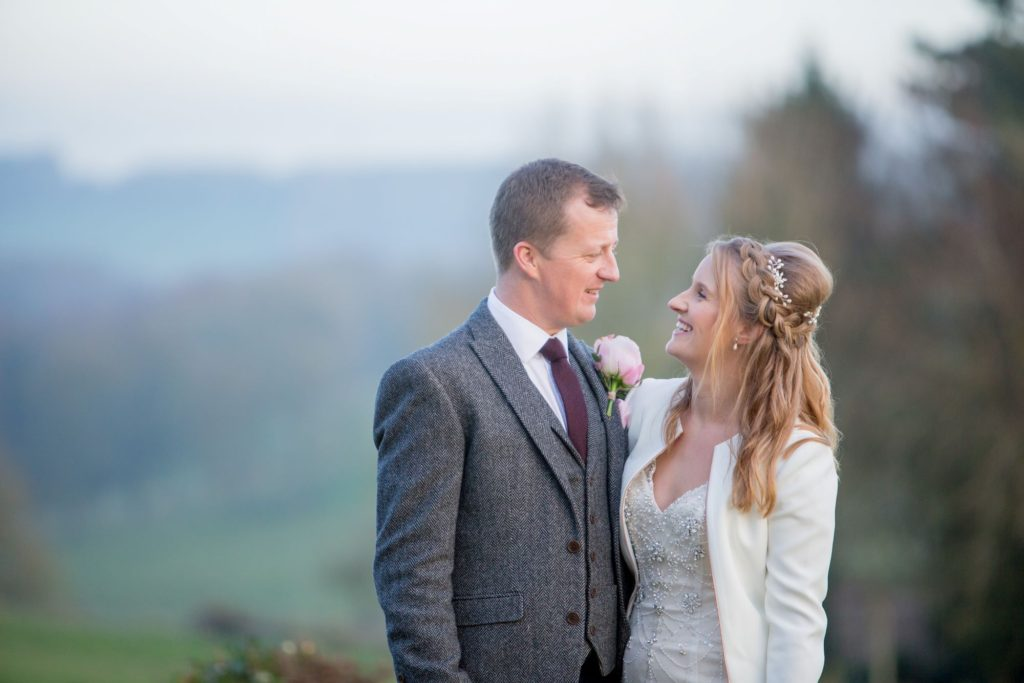 bride and groom in love kingscote barn grounds tetbury oxfordshire wedding photographers