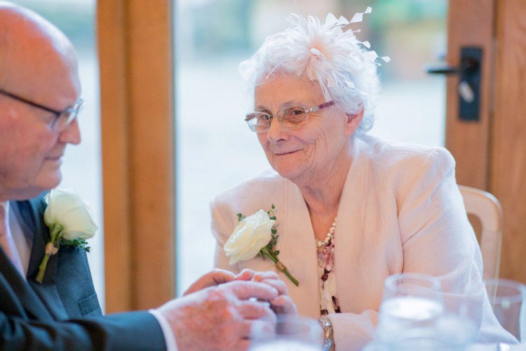 elderly guests enjoy reception dinner kingscote barn tetbury oxford wedding photography