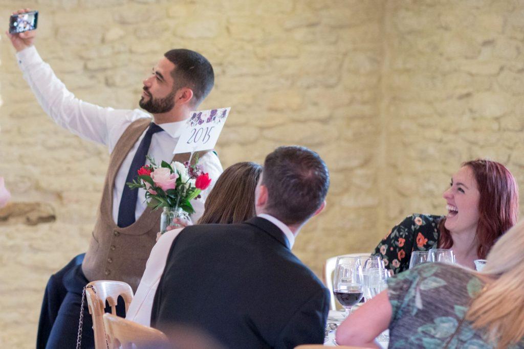 guests reception dinner selfie kingscote barn tetbury oxfordshire wedding photographer