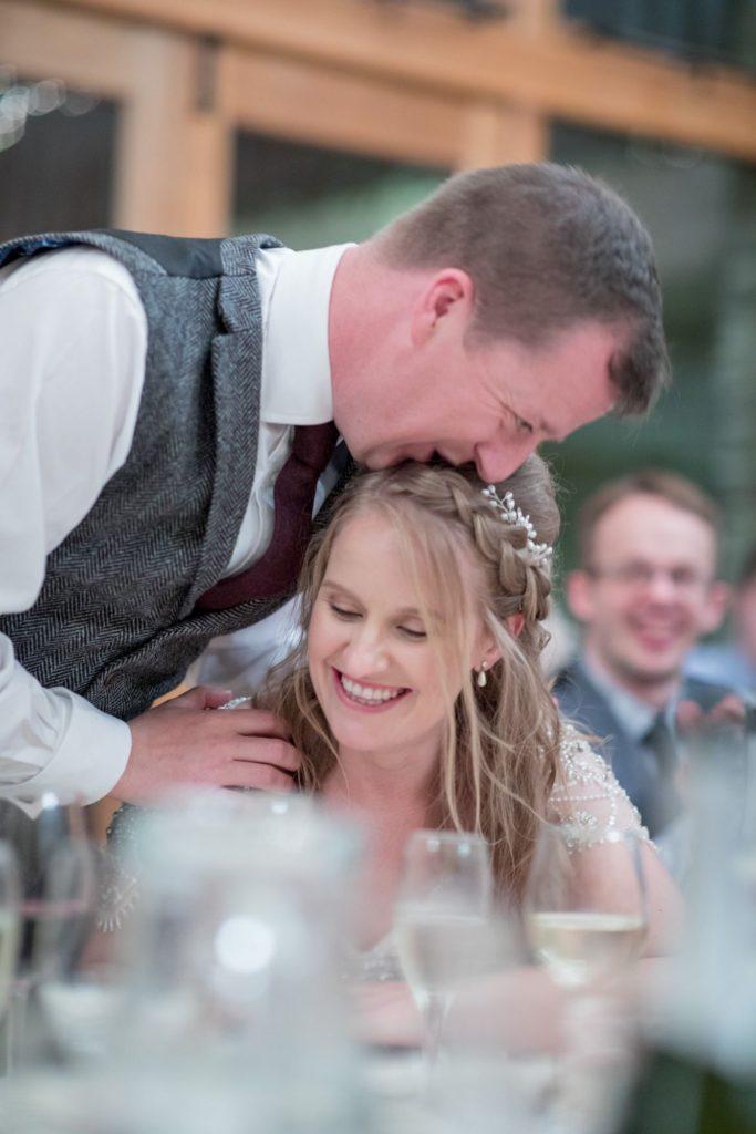bride groom joke during reception speeches kingscote barn tetbury oxfordshire wedding photographers