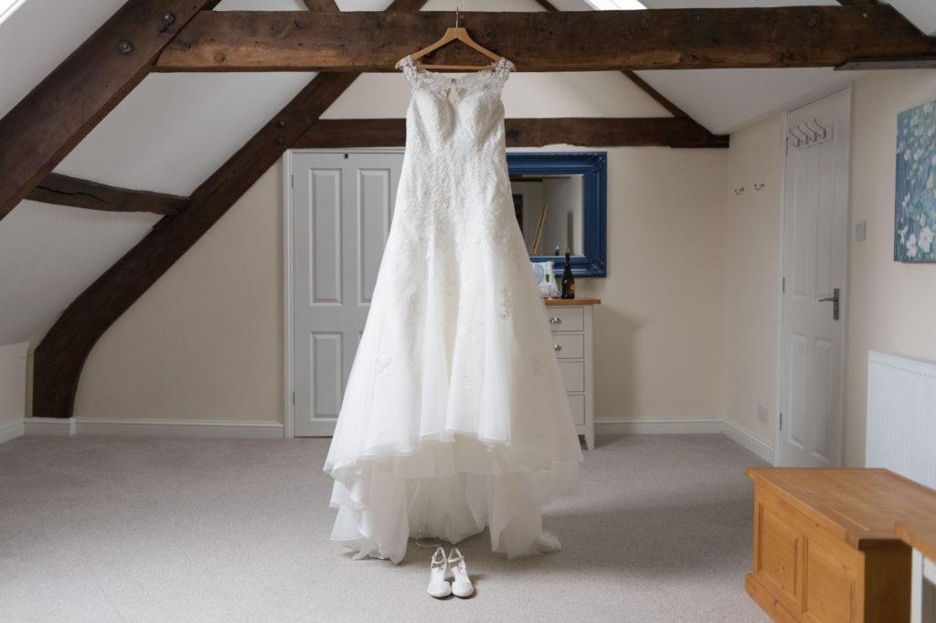 bride preparation long white flowing dress berkeley castle gloucestershire oxfordshire wedding photography