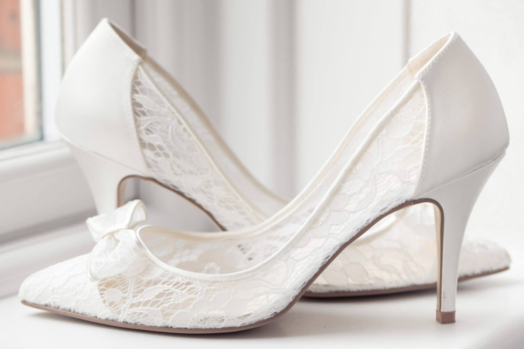 brides beautiful white shoes st ermins hotel westminser london oxford wedding photographers