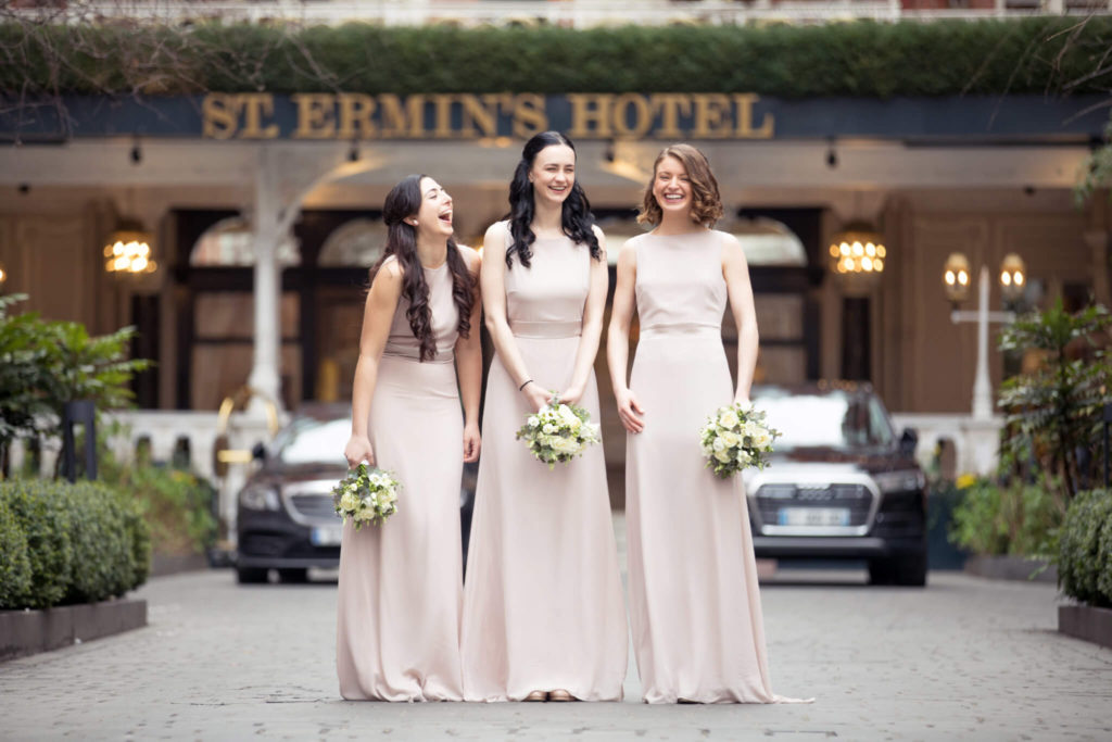 laughing bridesmaids st ermins hotel westminster london oxfordshire wedding photographers