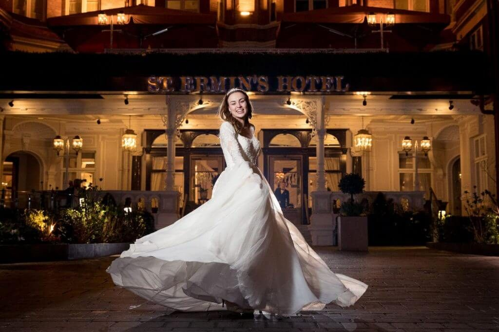 bride flowing white dress twirls outside luxury star st.ermins hotel london venue oxfordshire wedding photography