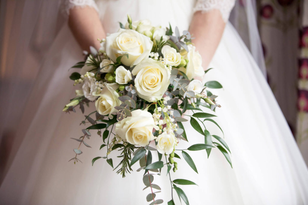 bride white roses bouquet st ermins hotel westminster london oxfordshire wedding photographers