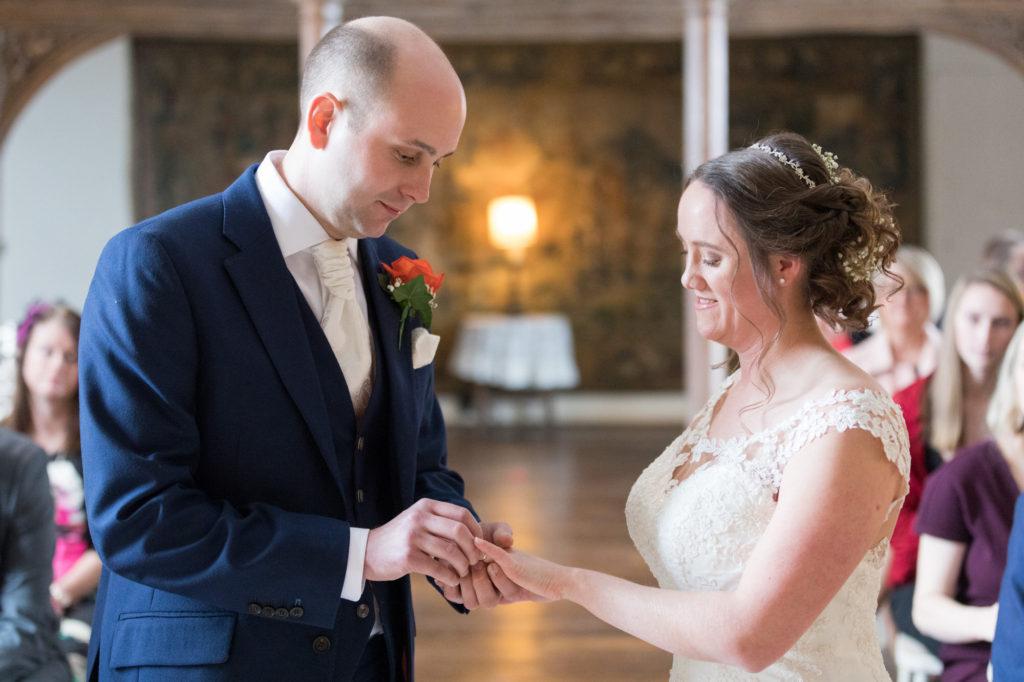 bride groom exchange rings marriage ceremony berkeley castle gloucestershire oxfordshire wedding photography