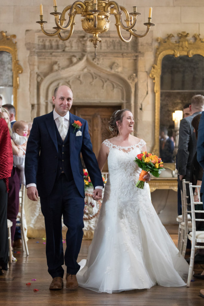 bride groom walk down aisle marriage ceremony berkeley castle stately home venue gloucestershire oxford wedding photography