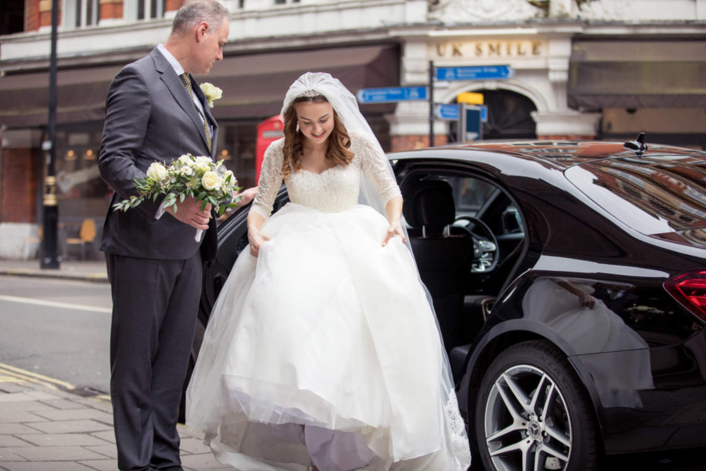 bride leaves bridal car westminser chapel london oxfordshire wedding photography