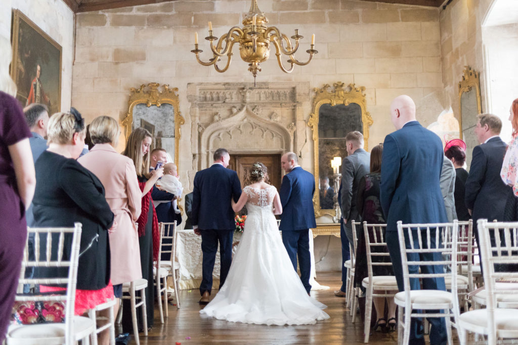 bride groom bestman at alter during marriage ceremony berkeley castle gloucestershire oxfordshire wedding photography