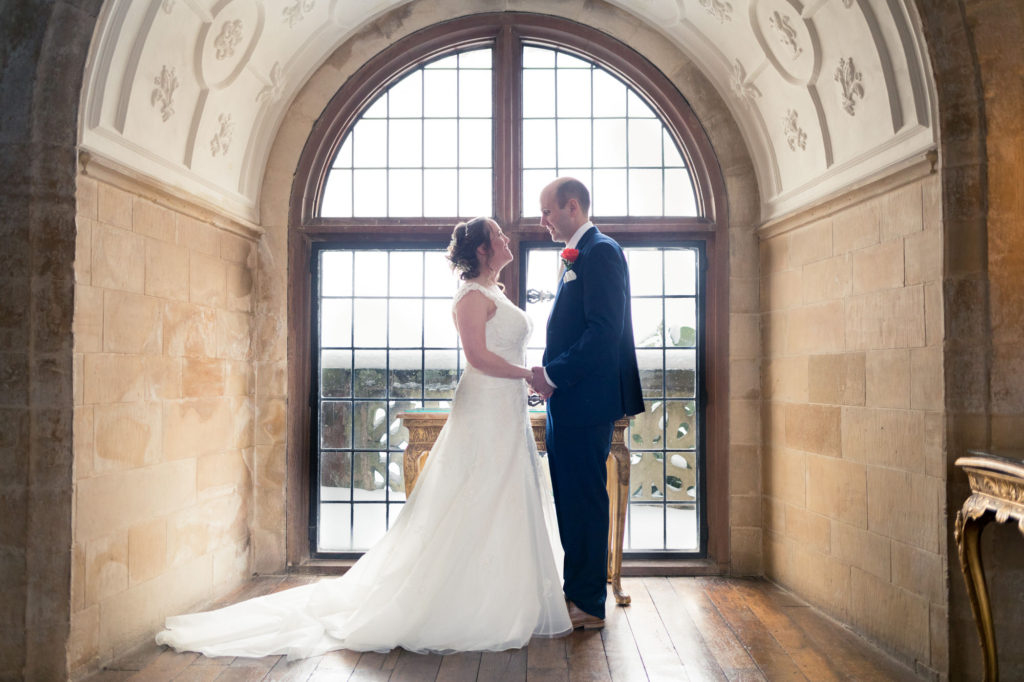 bride groom pose for traditional family portrait together berkeley castle gloucestershire oxfordshire wedding photographer