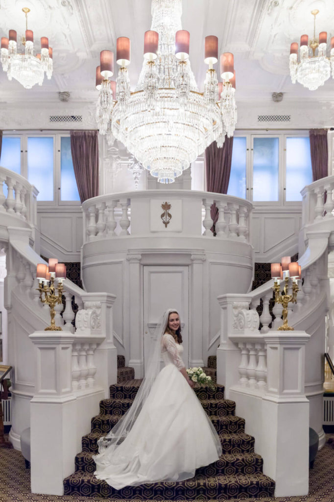 bride portrait on staircase st ermins hotel westminster london oxford wedding photographer