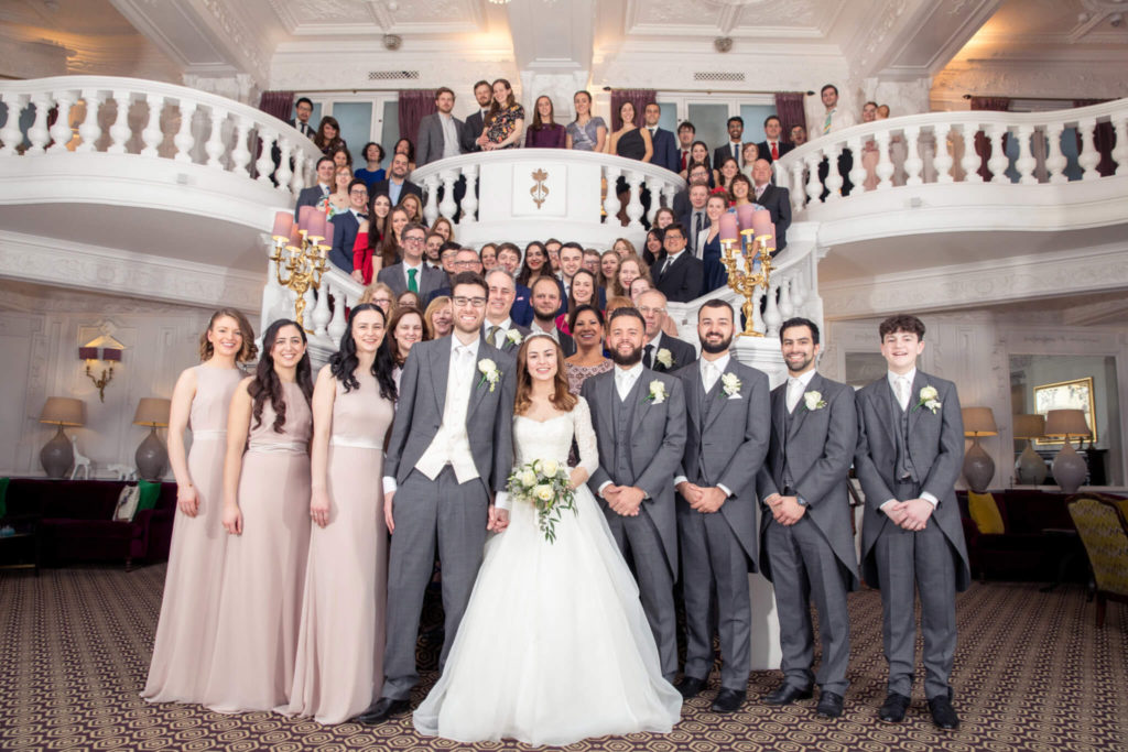 wedding party formal portrait on staircase st ermins hotel westminster london oxford wedding photographer