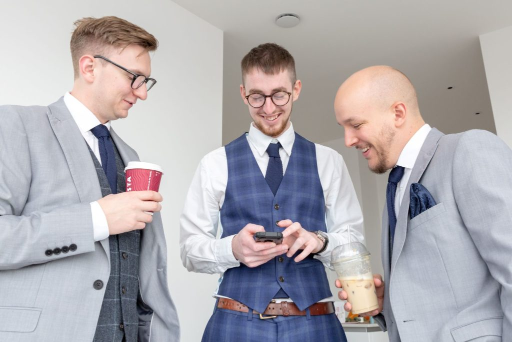 groom groomsmen check phone before marriage ceremony marylebone london oxfordshire wedding photographer