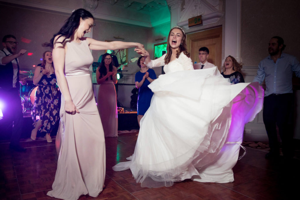 bride dances with bridesmaid st ermins hotel westminster london oxford wedding photographer
