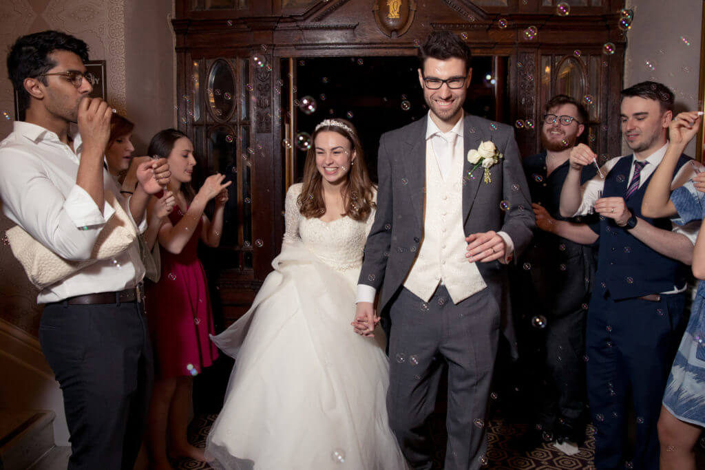 guest blow bubbles bride groom depart st ermins hotel westminster london oxford wedding photographer