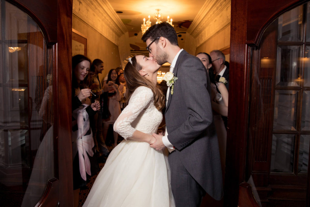 20 bride groom kiss at dinner reception st ermins hotel westminster london oxford wedding photography