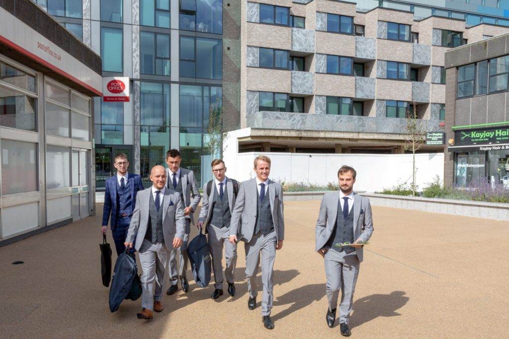 groom groomsmen leave hotel for st marys church marylebone london oxford wedding photographer