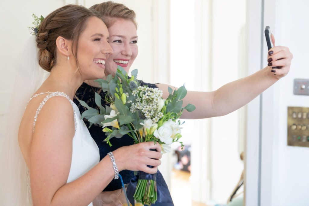 bride bridesmaid take selfie st marys church marriage marylebone london oxford wedding photography