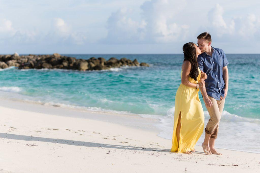 engagement couple kiss on beach atlantis hotel bahamas oxford wedding photographer
