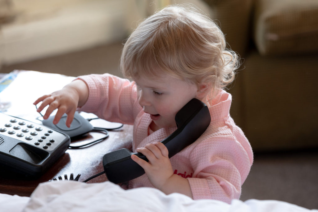 brides daughter telephones during bridal prep de vere selsdon estate croydon oxfordshire wedding photographers