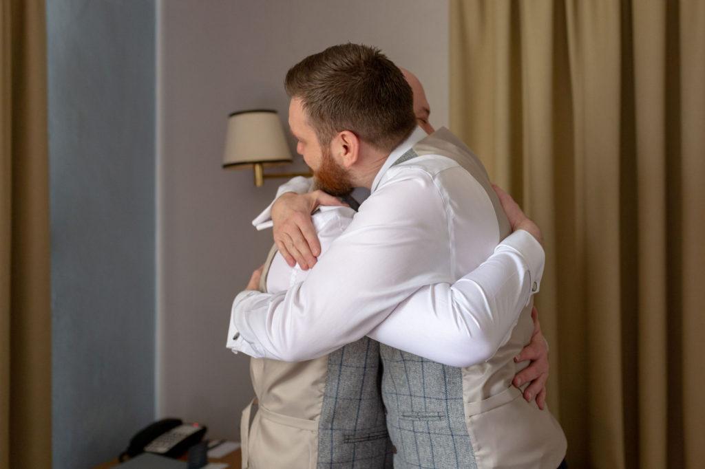 groom hugs bestman de vere selsdon estate croydon oxford wedding photographers