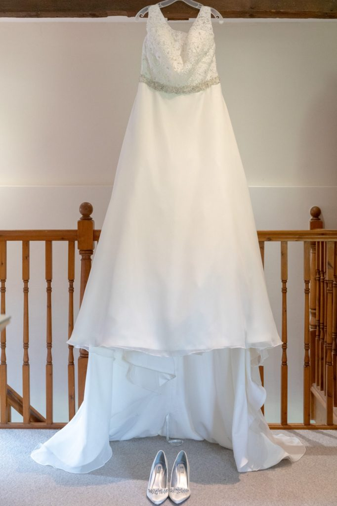 brides white dress and shoes oaks farm wedding venue surrey oxford wedding photographer