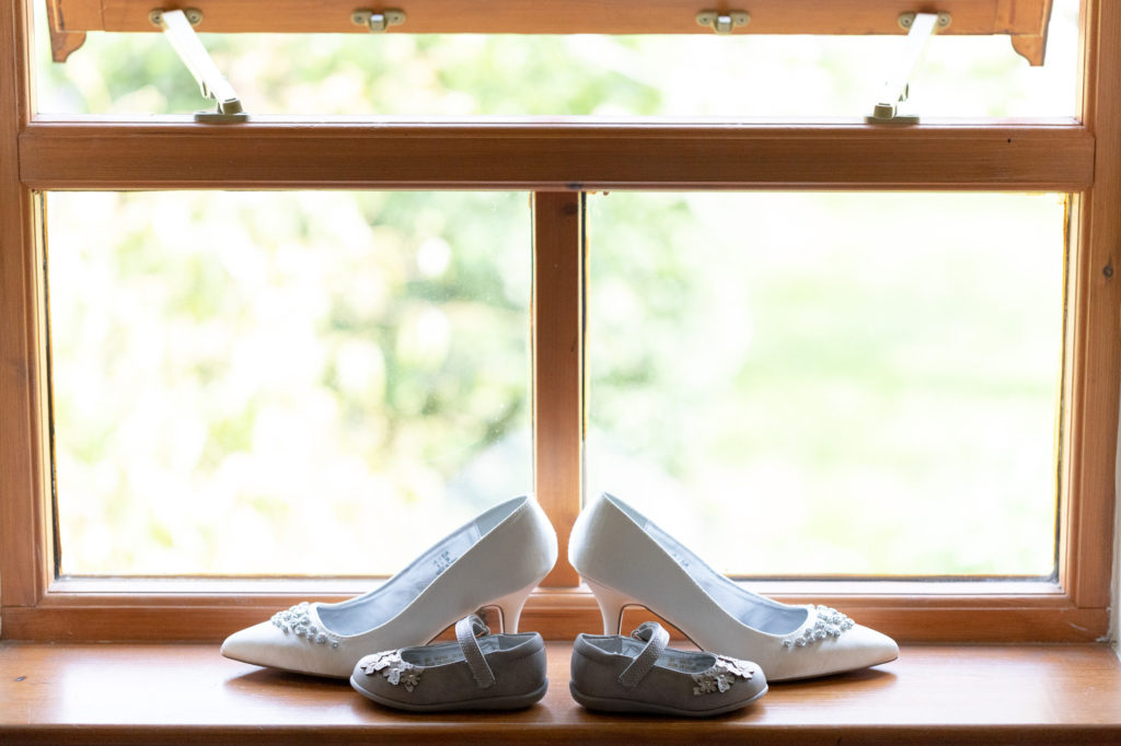 bride and child shoes oaks farm wedding venue surrey oxford wedding photographers