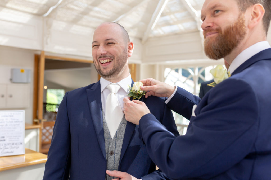 bestman checks grooms buttonhole flower oaks farm wedding venue surrey oxford wedding photographers