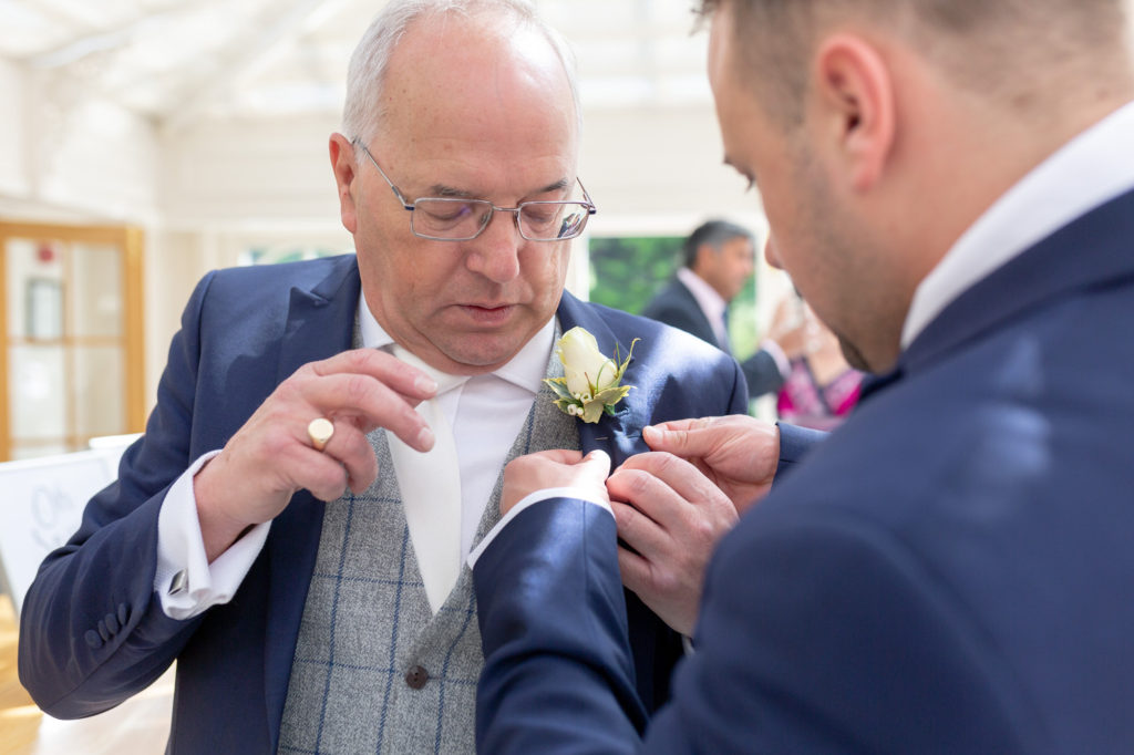 button hole flower for father of the groom oaks farm wedding venue surrey oxford wedding photographers