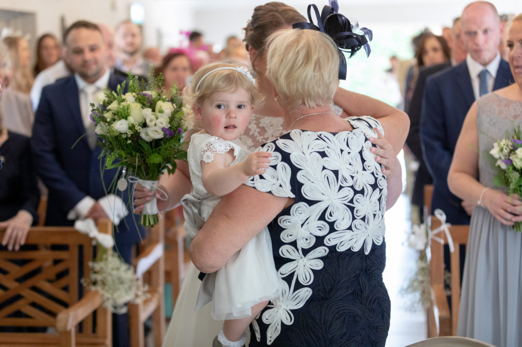 bride mother and child hug before marriage ceremony oaks farm surrey oxford wedding photographer