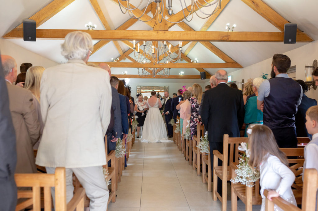 guests at marriage ceremony oaks farm wedding venue surrey oxford wedding photographers
