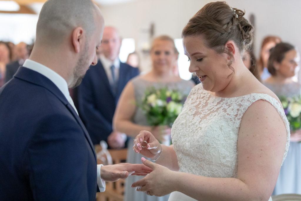 bride groom exchange rings marriage ceremony oaks farm surrey oxford wedding photographer