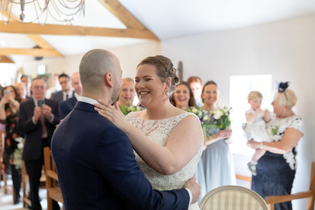 smiling bride groom marriage ceremony oaks farm surrey oxford wedding photographers