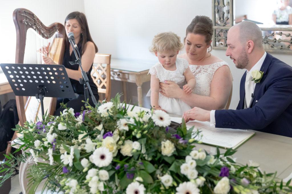 bride goorm child harpist at register signing ceremony oaks farm surrey oxfordshire wedding photographer