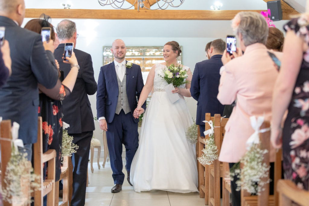 bride groom walk down aisle oaks farm wedding venue surrey oxfordshire wedding photographers