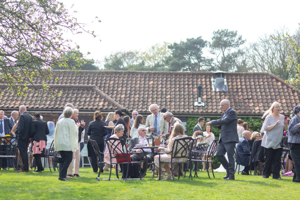 guests at garden reception oaks farm wedding venue surrey oxford wedding photographers