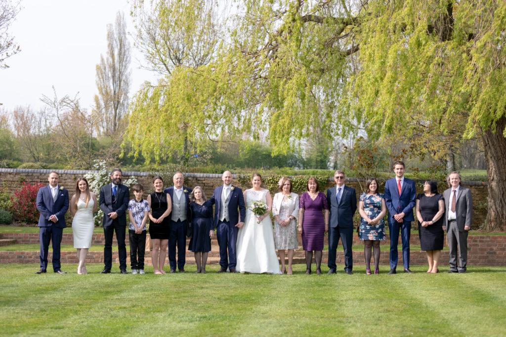 bride groom and family wedding portrait oaks farm gardens surrey oxford wedding photographers