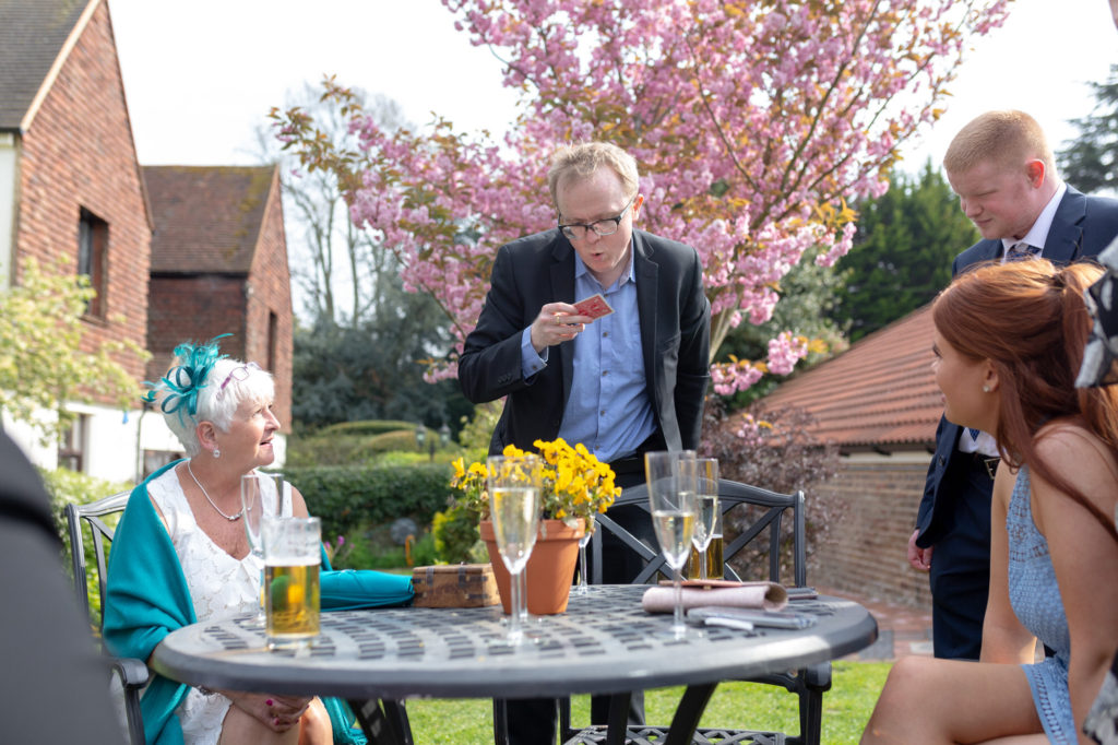 card tricks at garden reception oaks farm wedding venue surrey oxfordshire wedding photography