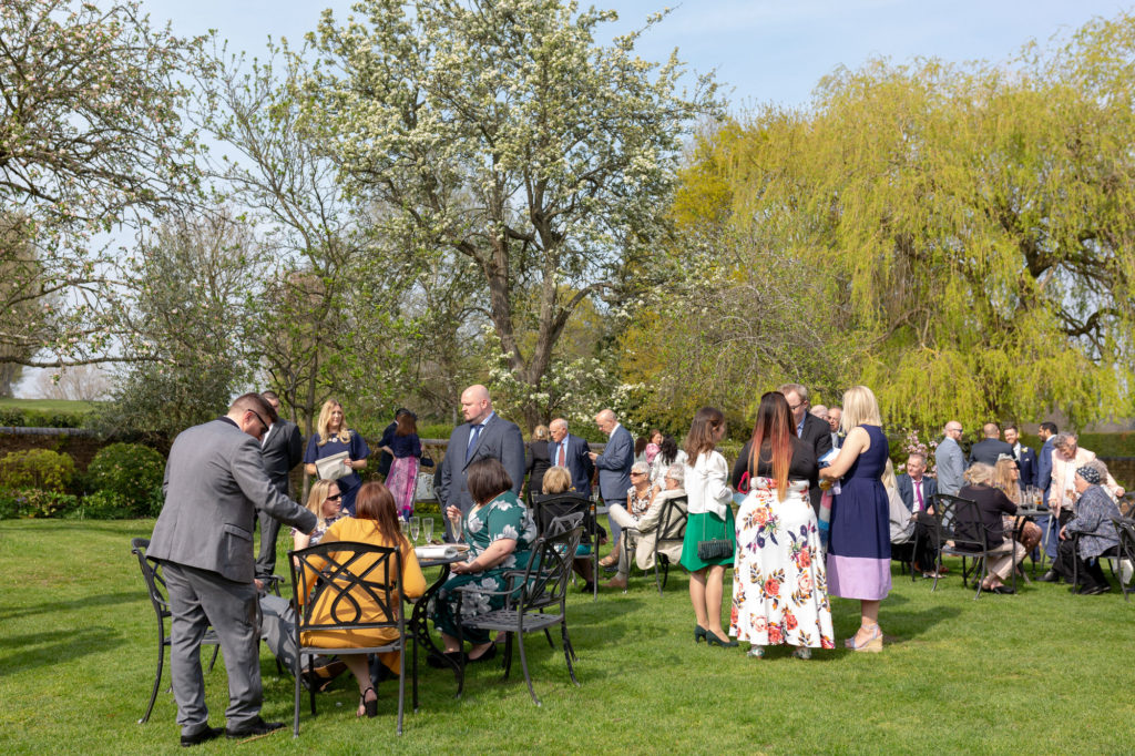 guests at garden reception oaks farm wedding venue surrey oxford wedding photographer