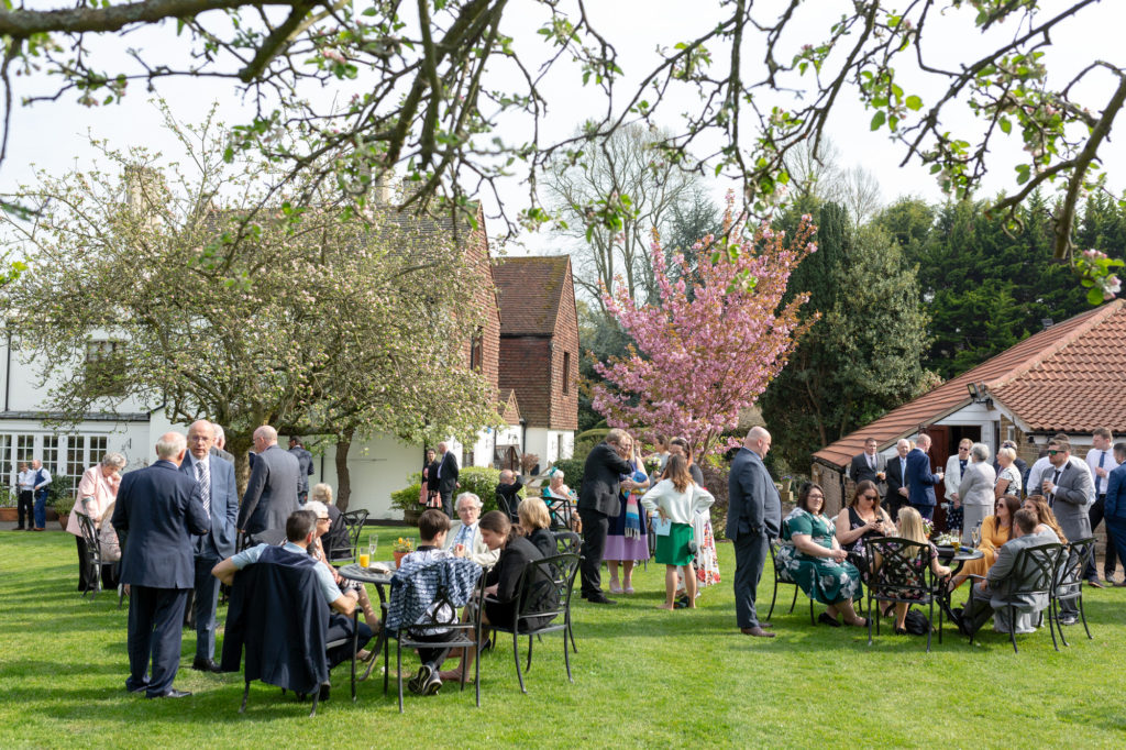 guests enjoying drinks oaks farm wedding venue gardens surrey oxford wedding photographer