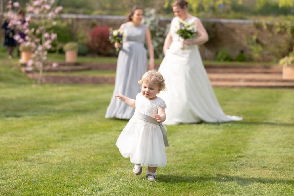 running flower girl oaks farm wedding venue garden surrey oxford wedding photographers