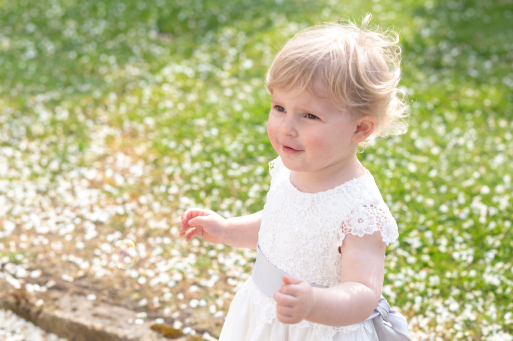 flower girl and daisies oaks farm wedding venue gardens surrey oxford wedding photography