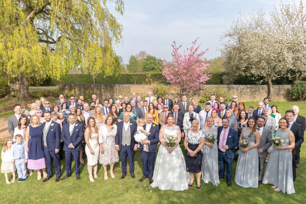 bride groom guests group portrait oaks farm wedding venue surrey oxfordshire wedding photographer
