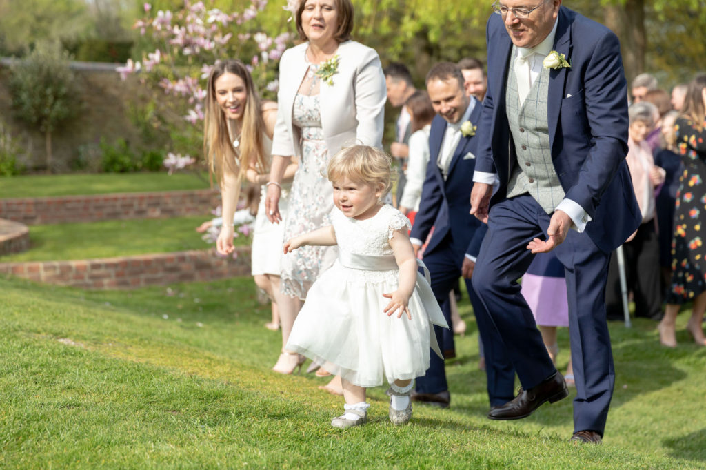 flower girl with grandparents oaks farm wedding venue surrey oxfordshire wedding photographers