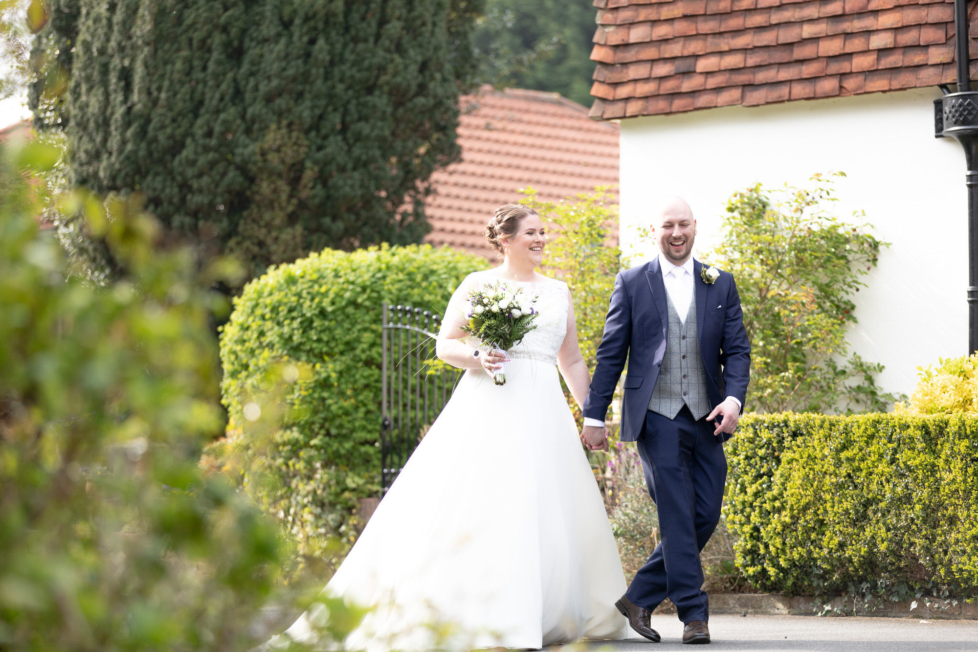 laughing bride groom garden stroll oaks farm surrey oxford wedding photographer