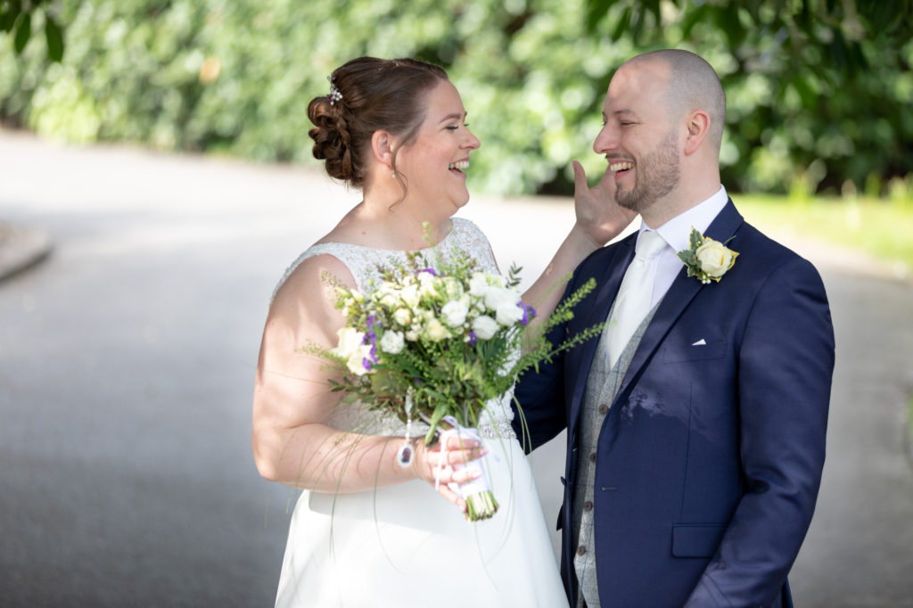 bride groom laugh together oaks farm grounds surrey oxford wedding photography