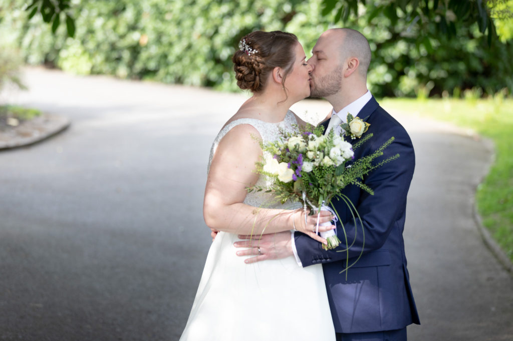 bride groom kiss oaks farm grounds oxfordshire wedding photographer