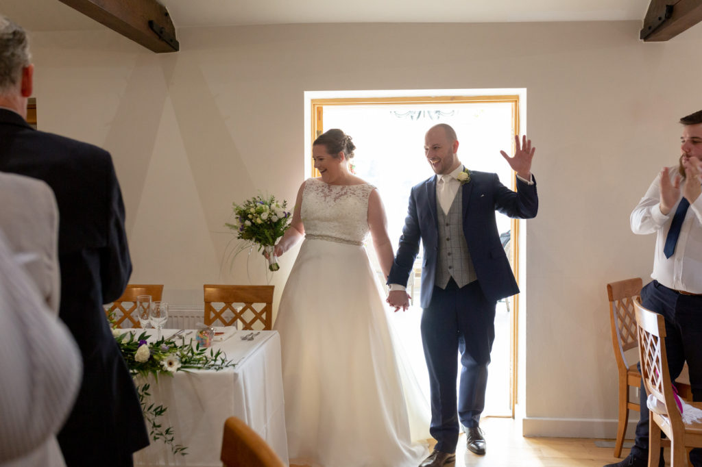 bride groom arrive at dinner reception oaks farm surrey oxford wedding photographer